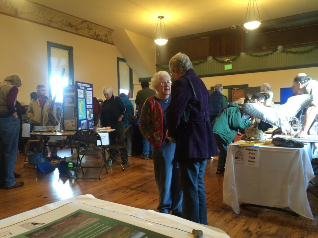Enthusiastic visitors and volunteers discuss the unique birding opportunities in Skagit and Snohomish County.